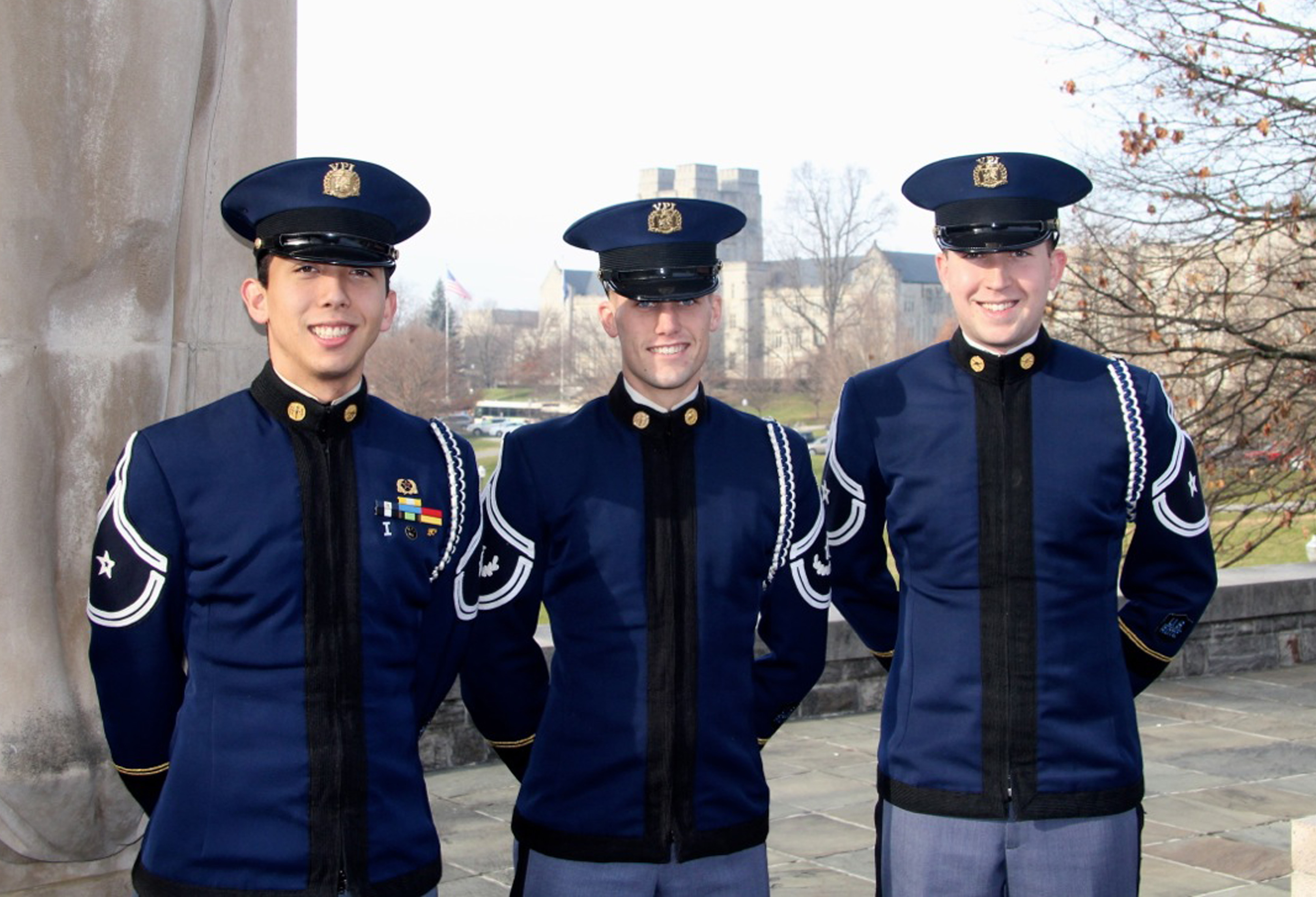 From left to right are Cadets Dustin Caranci, Austin Burns, and Brett Cowell standing at the Pylons