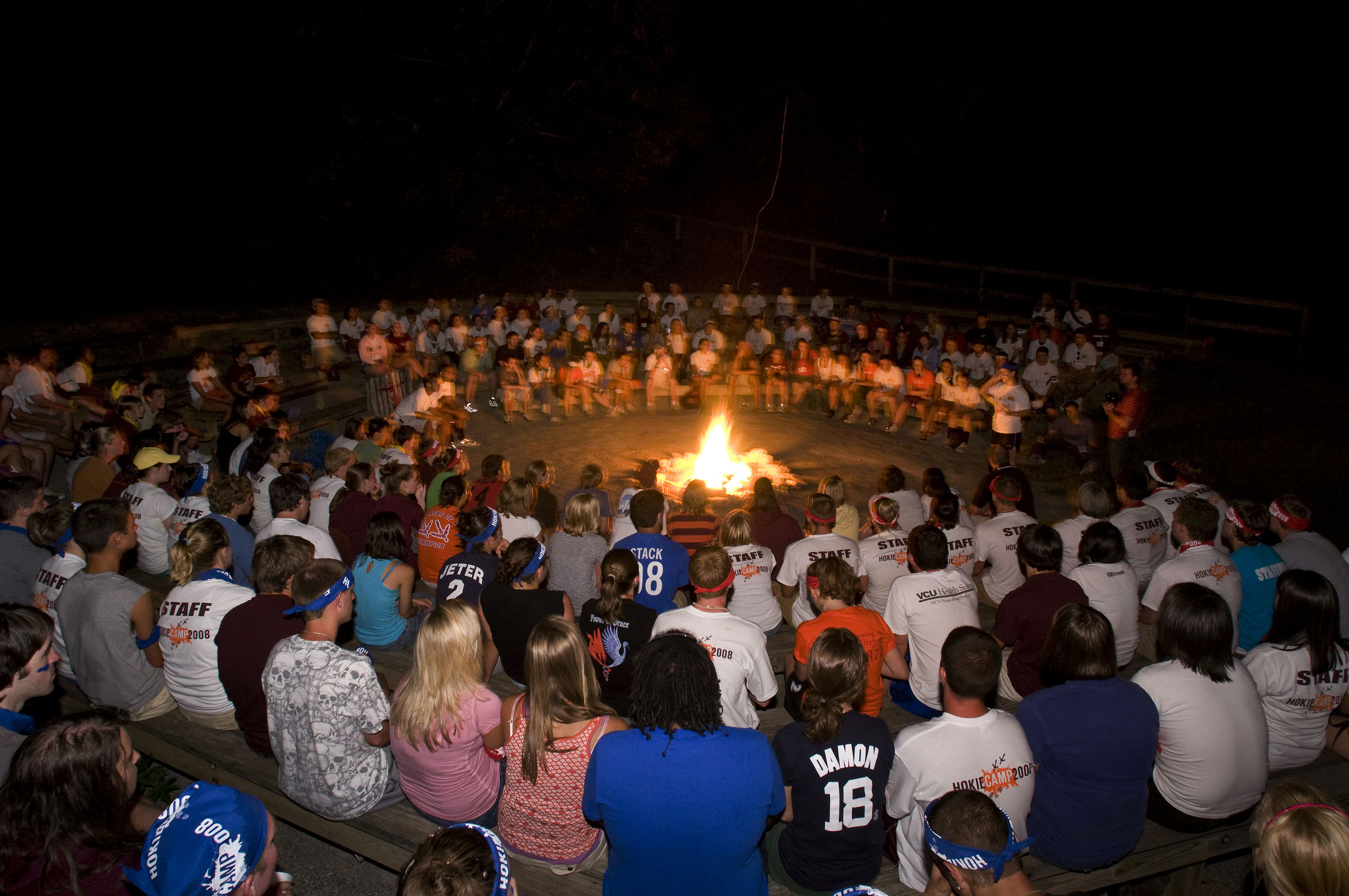 Hokie Campers sit around camp fire