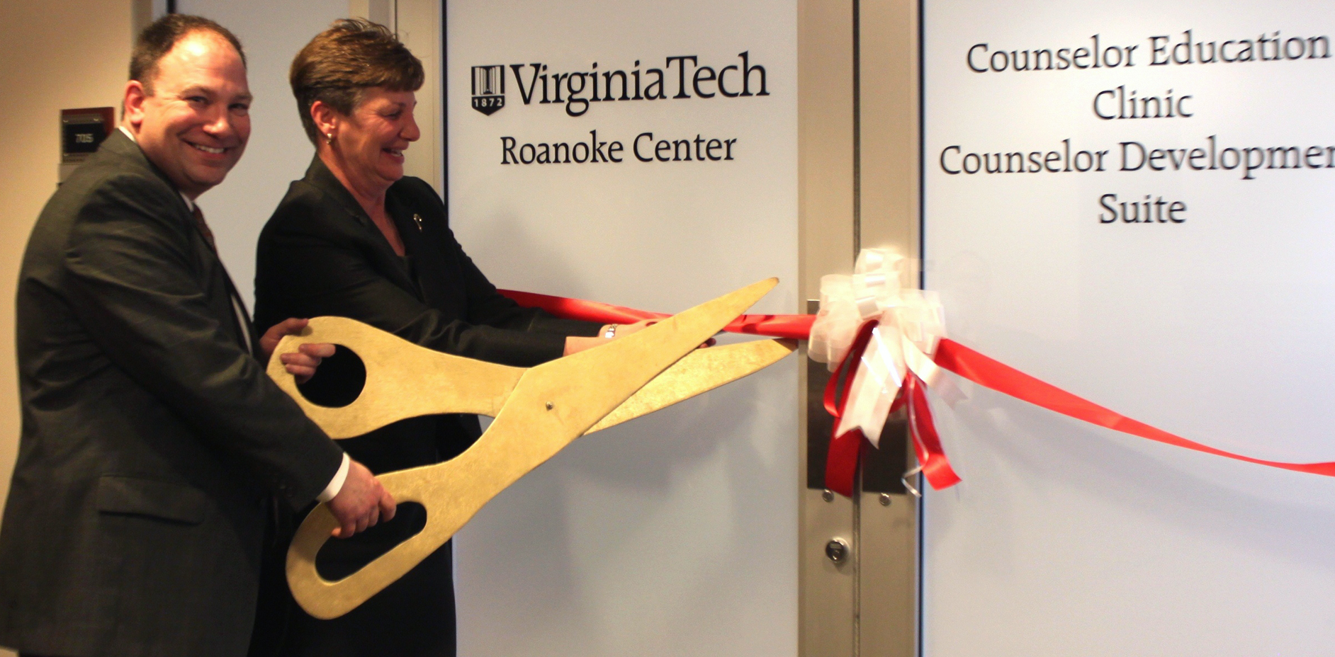 Gerard Lawson and Susan Short of Virginia Tech cut ribbon.