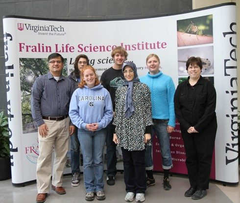 Members of Pablo Sobrado's research team. First row (left to right): Pablo Sobrado, Michelle Oppenheimer, and Reyhaneh Ojani. Second row (left to right): Mike Fedkenheuer, Reeder Robinson, Karina Kizjakina, and Nancy Vogelaar.