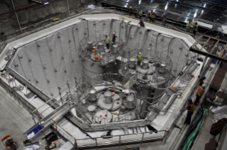 The three anti-neutrino detectors used to study the behavior of neutrinos are being prepared in a dry pool. Later it's filled with water to do experiments. Virginia Tech physicists joined an international collaboration that recently found new information about neutrino behavior.
