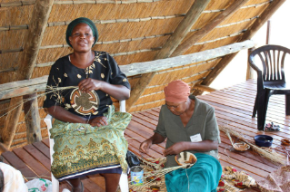 At the craft center, women make and sell palm baskets and other crafts to tourists who come to see Botswana's plentiful wildlife, providing the women a much-needed source of income.
