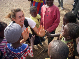 Virginia Tech student Caitlin Mitchell works with children during her study abroad experience in Ghana.