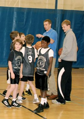 Taylor Kewer and Derek Baker coach fifth graders in Blacksburg Recreation league basketball.