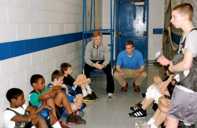 Derek Baker and Taylor Kewer conduct a post-game debriefing with Blacksburg Recreation league basketball players.