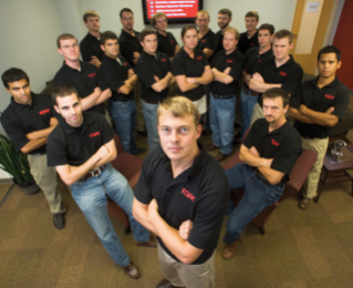 TORC Robotics co-founder and CEO Michael Fleming, a graduate of Virginia Tech, with his team