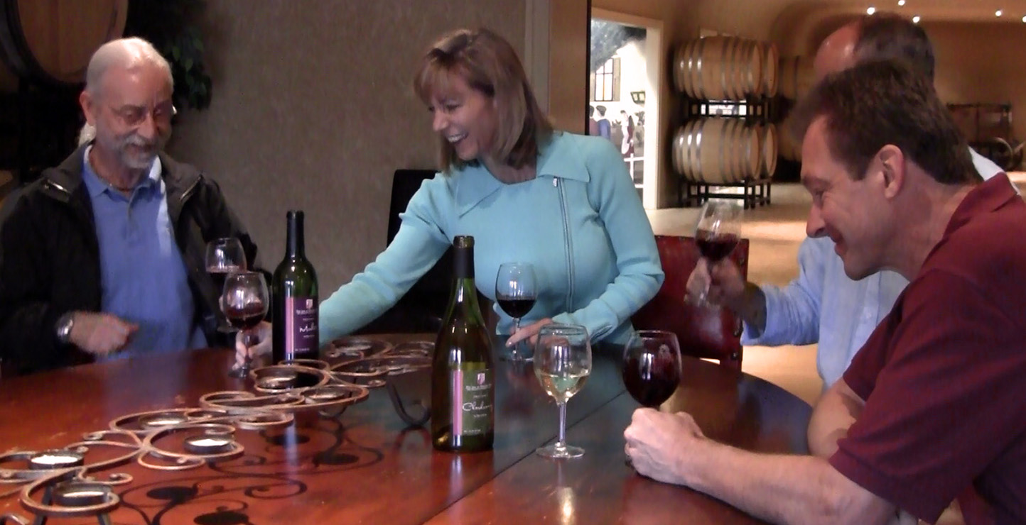 A seated group of people tasting wines.