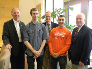 Left to right:  Joe Meredith, president of the Virginia Tech Corporate Research Center; Kevin Dickel of Focus Radio; Dick Daugherty, director of strategic services for VT KnowledgeWorks; Matt Flamini of Focus Radio; and Jim Flowers, executive director of VT KnowledgeWorks.  Not pictured:  Jake Overfield and Chris Mortweet of Focus Radio.
