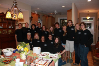 The 15 undergraduate and graduate students who participated in Actively Caring for People's trip to Chardon High School on May 15, 2012, enjoy good food and company after their visit.
