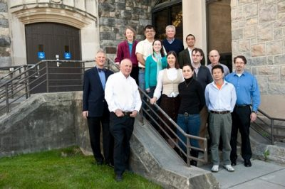 Members of the Virginia Tech Center for Drug Discovery pose in front of Hahn Hall.