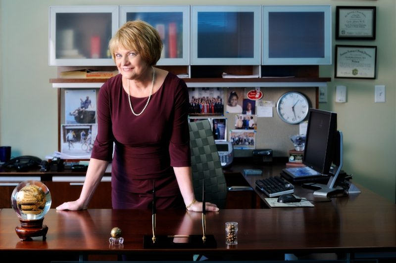 Cynda Johnson stands at her desk
