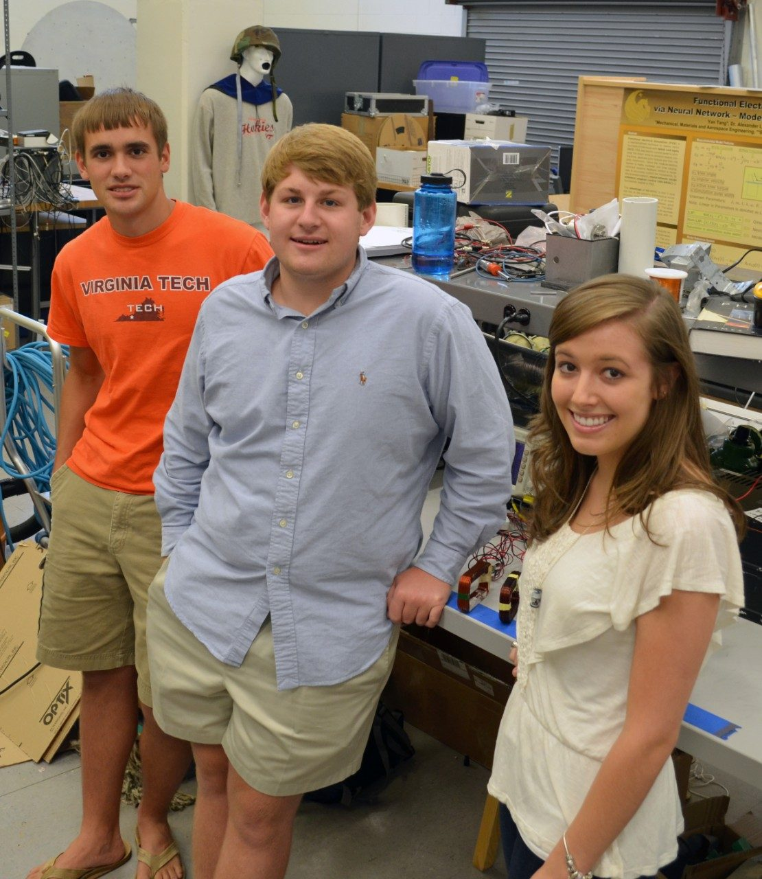 Scieneering students Garret Burks, Kyle Harring, and Madison Preib (left to right) stand in their summer research laboratory space in Durham Hall.