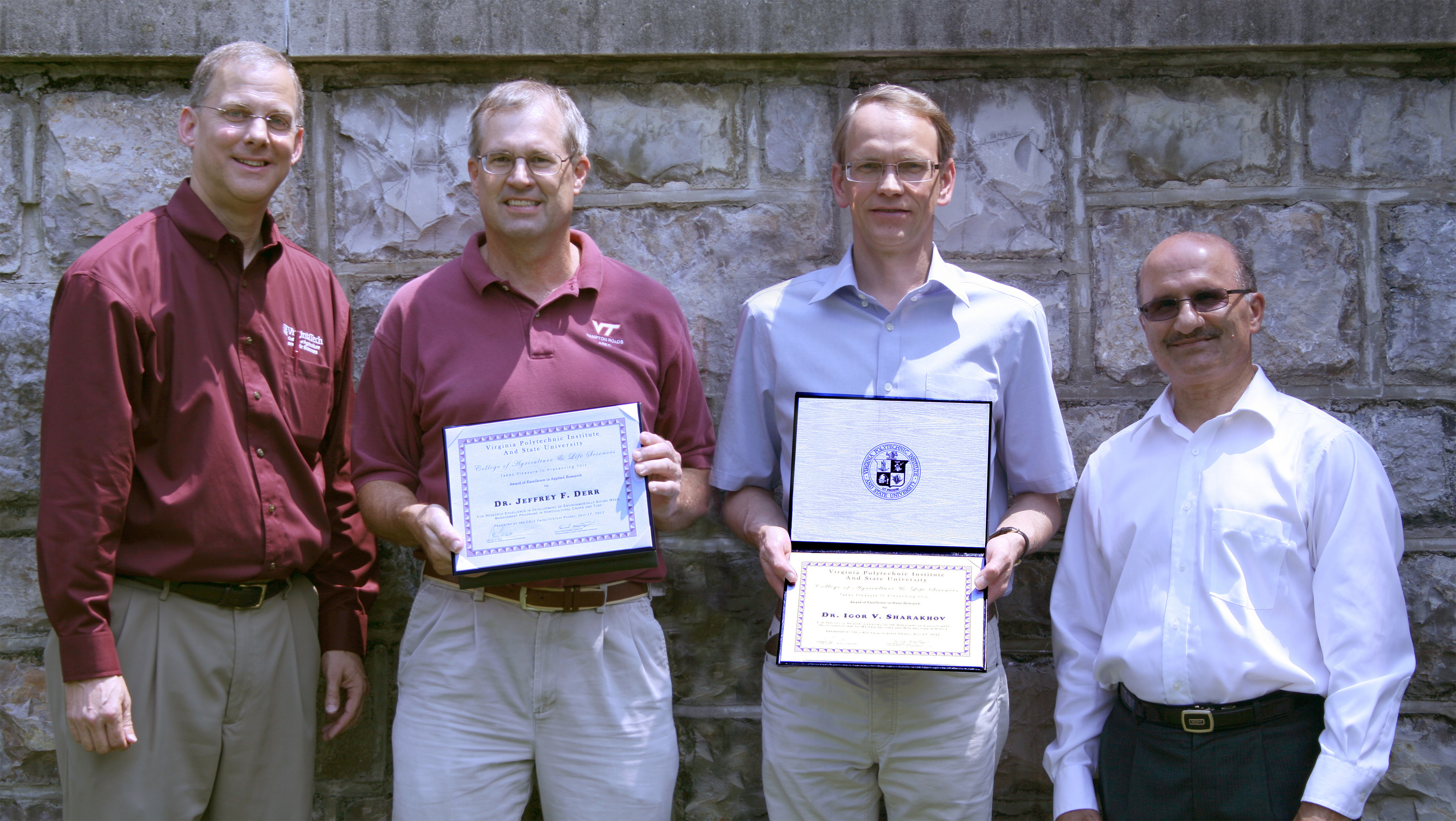 Pictured left to right: Alan Grant, Jeffrey Derr, Igor Sharakhov, and Saied Mostaghimi.  Jeffrey Derr and Igor Sharakhov hold their awards.