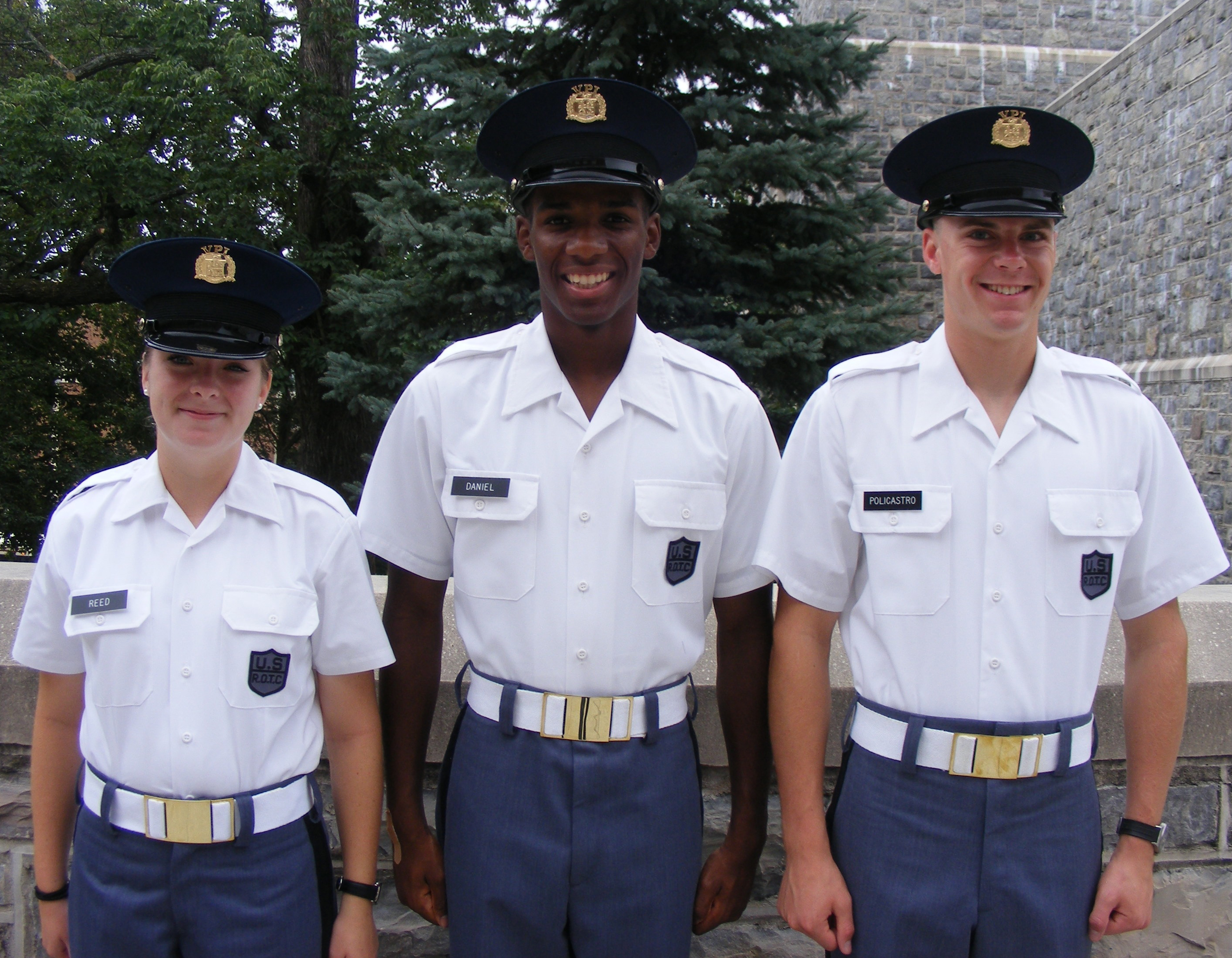 From left to right standing in front of Torgerson Hall are Cadets Samantha Reed, Lyndon Daniel, and Carlo Policastro