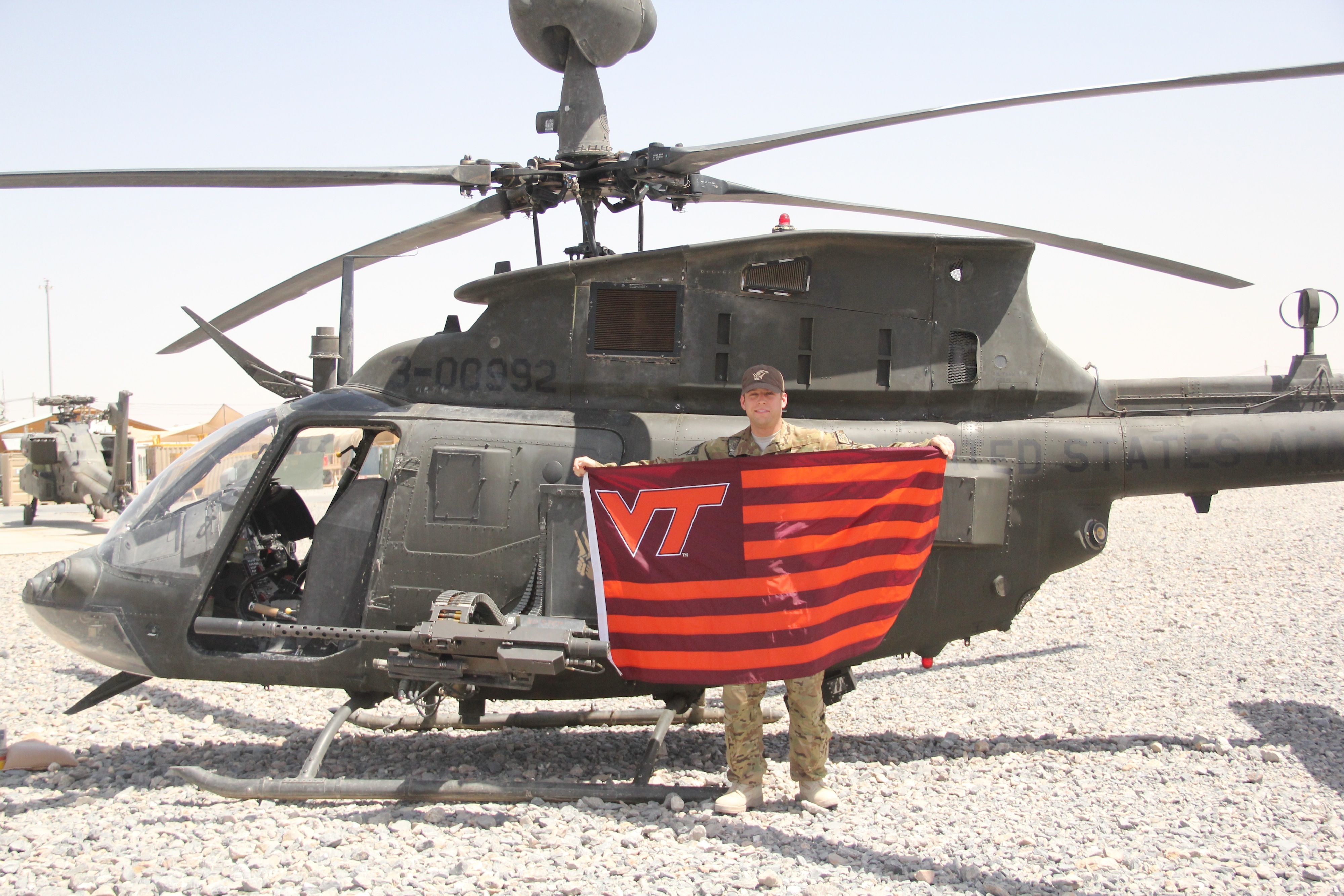 Capt. Andy Howell, U.S. Army, Virginia Tech Corps of Cadets Class of 2007 shown with his helicopter in Afghanistan