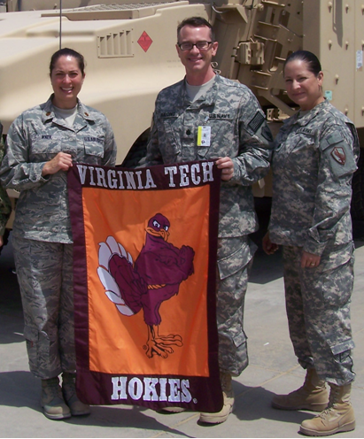 From left to right are Maj. Lisa Wnek, Air National Guard, Virginia Tech Corps of Cadets Class of 1999, Cdr. Bill Balding, U.S. Navy, Virginia Tech Corps of Cadets Class of 1989, and Lt. Col. Katy Garza-Bair, U.S. Army, Virginia Tech Corps of Cadets Class of 1985 while deployed in Afghanistan.