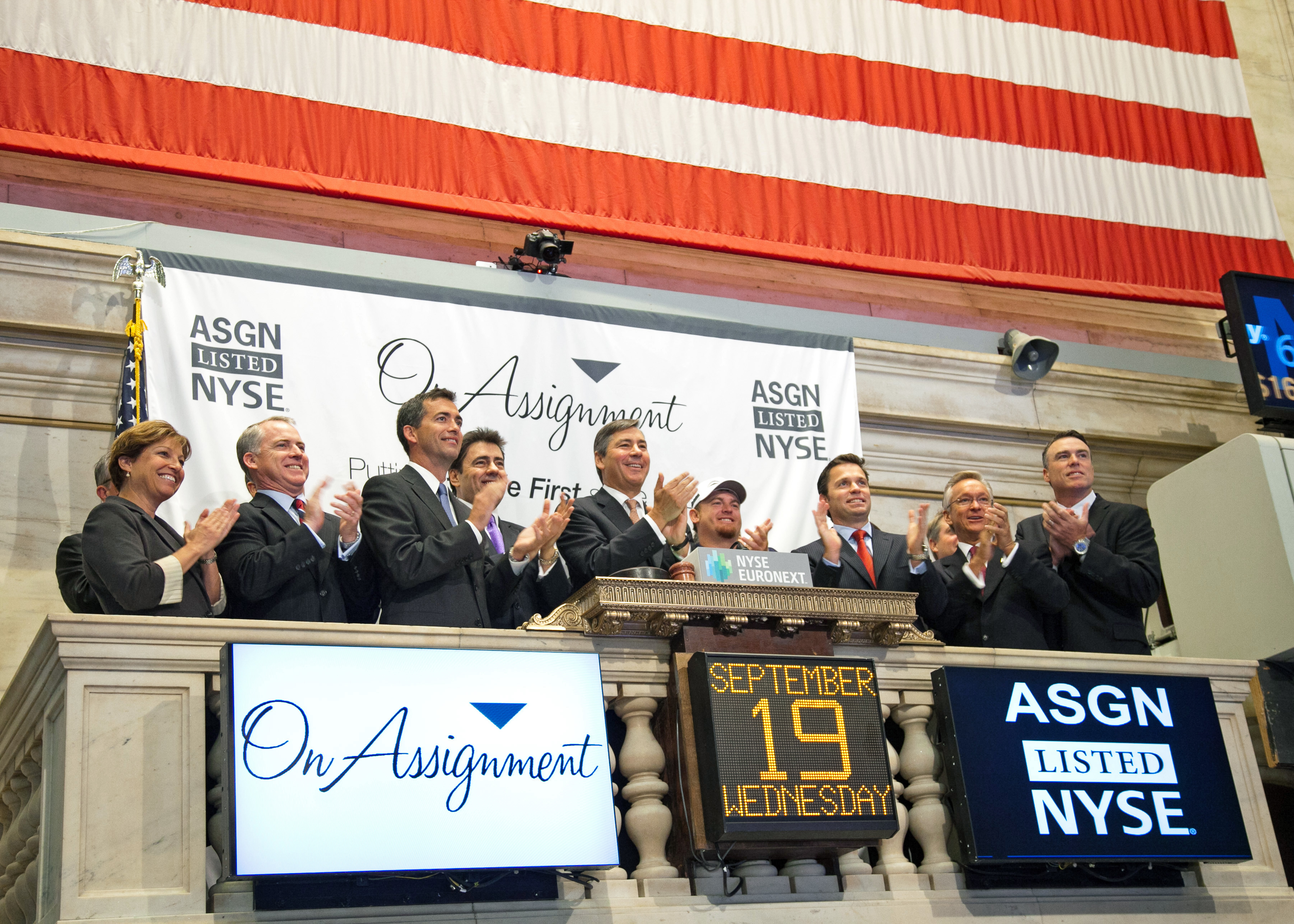 Jeff Veatch and others celebrate after ringing the opening bell at the New York Stock Exchange.