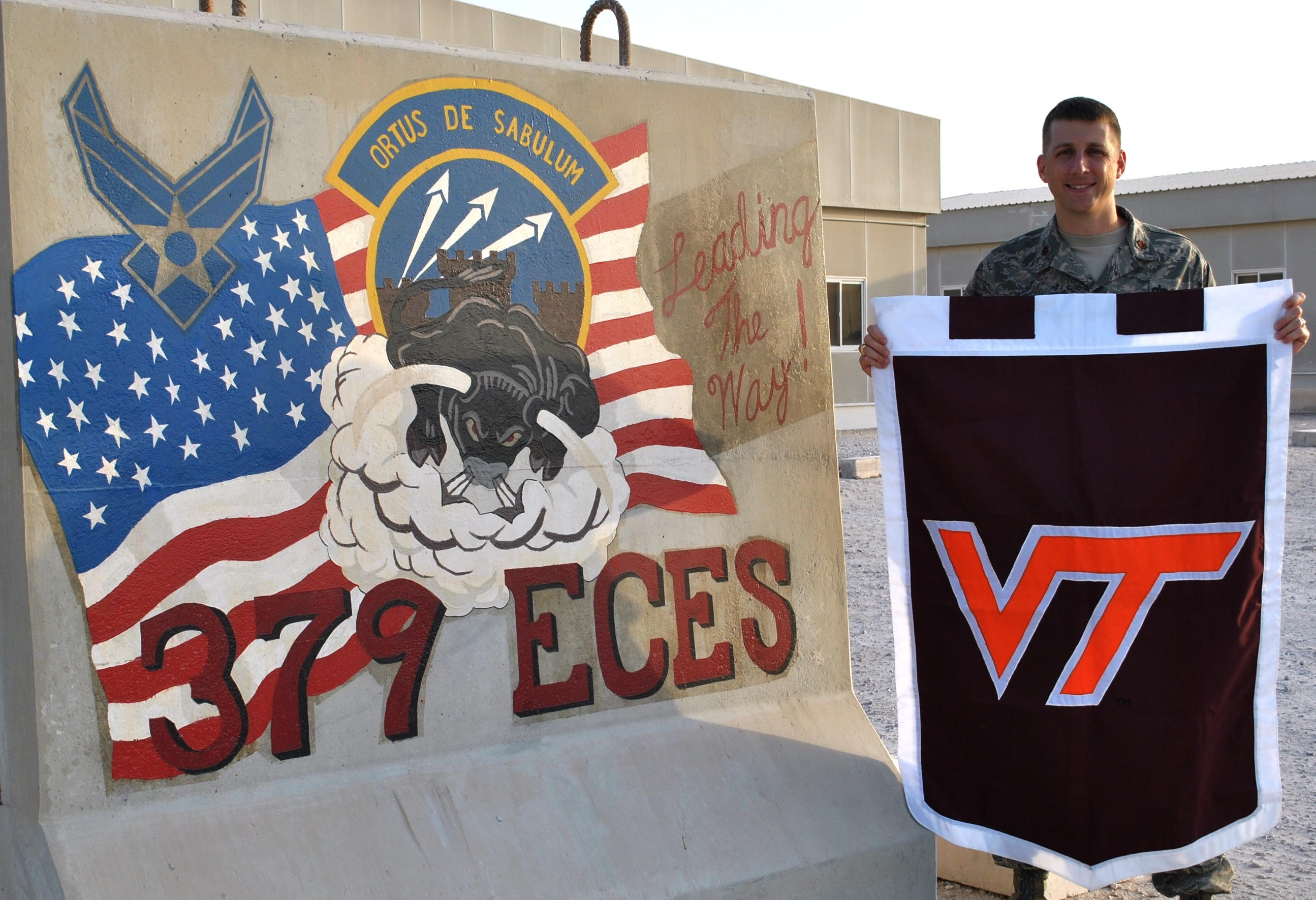Maj. Ryan Crowley, U.S. Air Force, Virginia Tech Corps of Cadets Class of 2001 next to his unit sign.