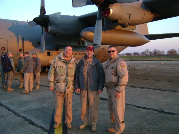 Lt. Col. Phil Millett, Kentucky Air National Guard, Virginia Tech Corps of Cadets Class of 1988 (center) shown with fellow crew members in front of their C-130 in route to Afghanistan.