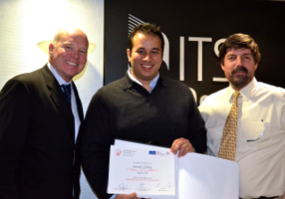 Ismail Zohdy received the best paper award during a November 2012 visit to the Intelligent Transportation Society of America headquarters in Washington, D.C. Pictured here are Scott F. Belcher, ITSA president and CEO; Zohdy; and Tom Kern, ITSA executive vice president.