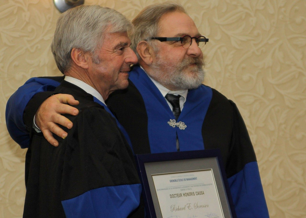 Pamplin Dean Richard E. Sorensen (left) was presented an honorary doctorate by Thierry Grange of the Grenoble Ecole de Management.