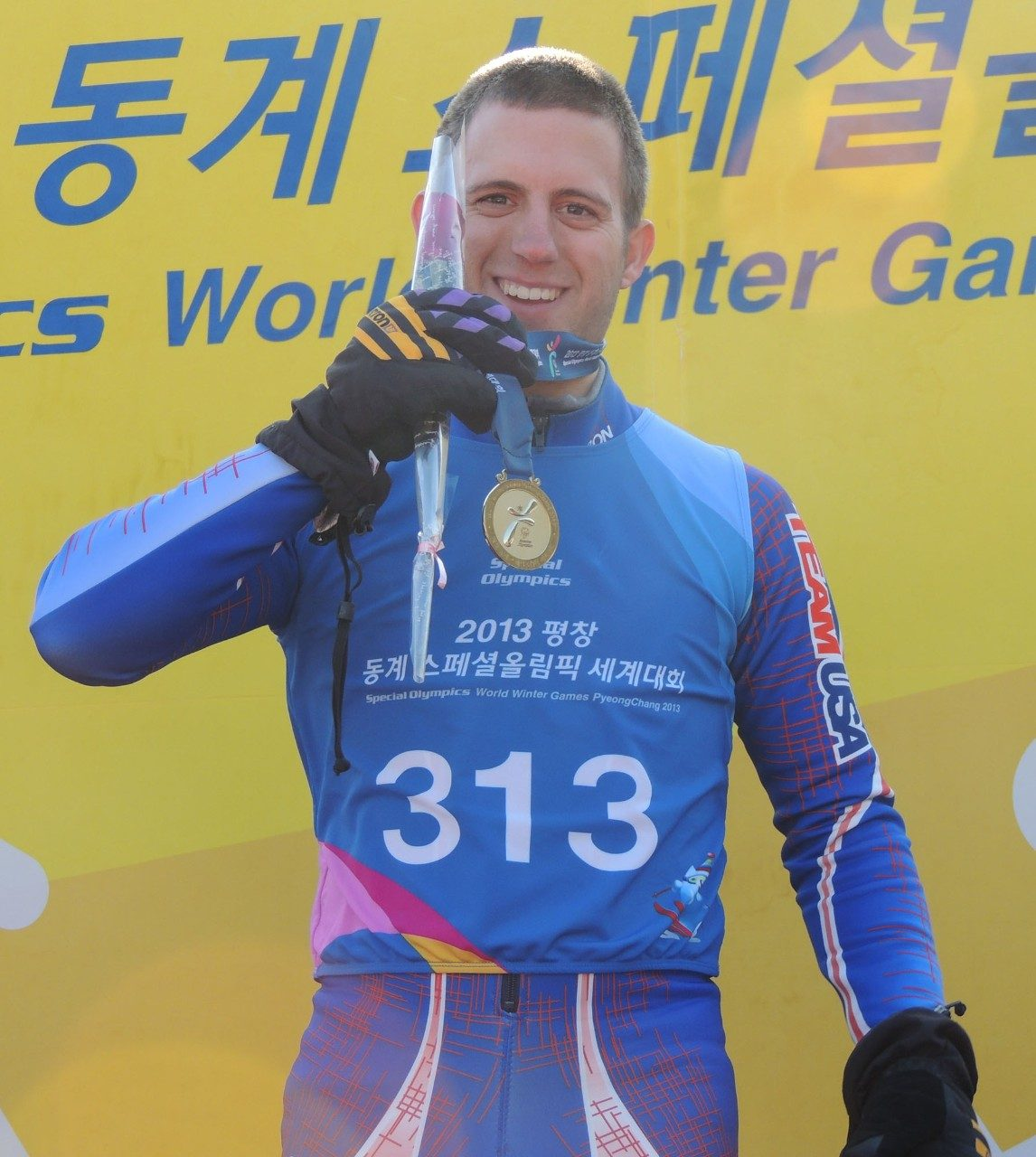 Ben Norris shows the gold medal he won in the Alpine Skiing Intermediate Super G event.