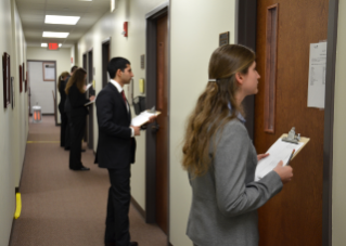 Before entering interview rooms, candidates for the veterinary college's Class of 2017 review one of eight scenarios that will test their non-cognitive abilities.