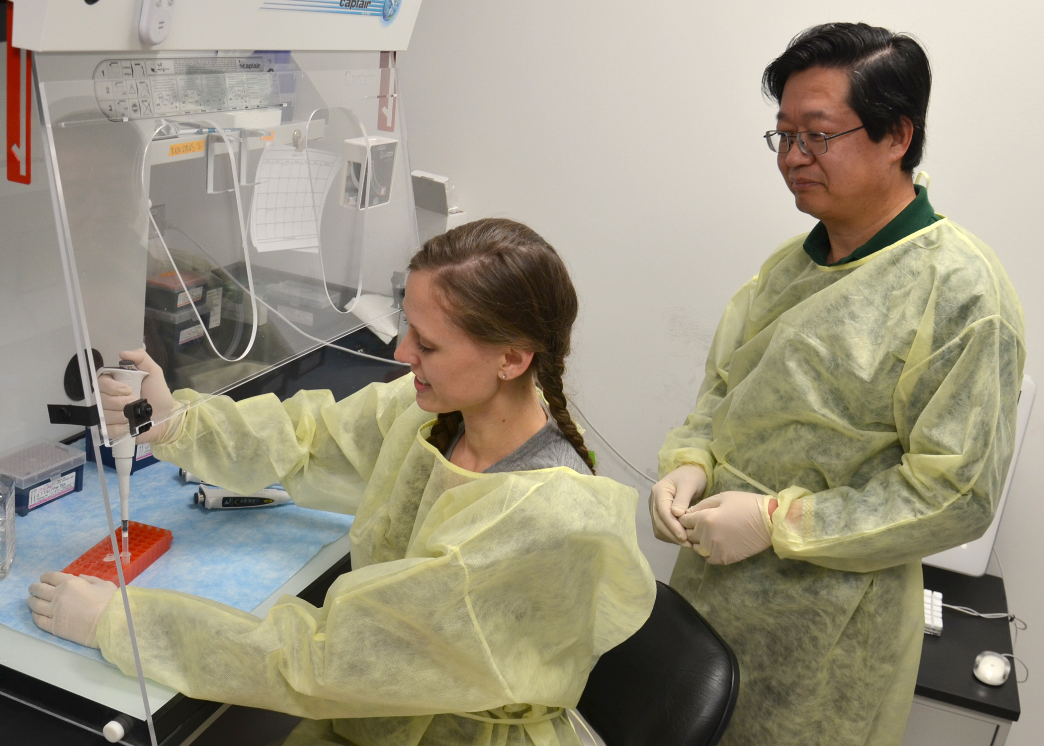 Dr. X.J. Meng and Dr. Danielle Yugo in the lab