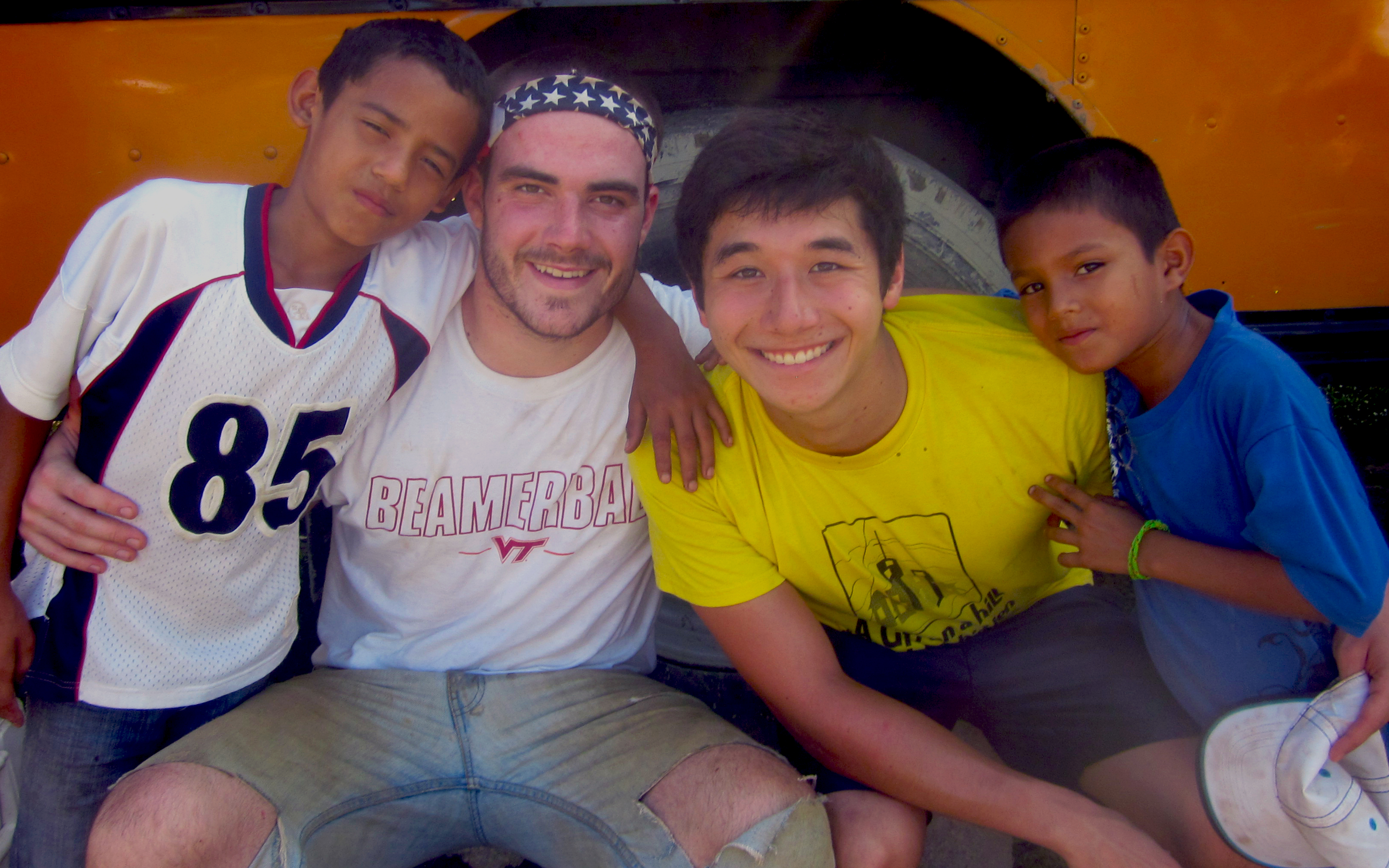 John Duffy (second from left) and Josh Enokida (third from left) pose with two Honduran boys.