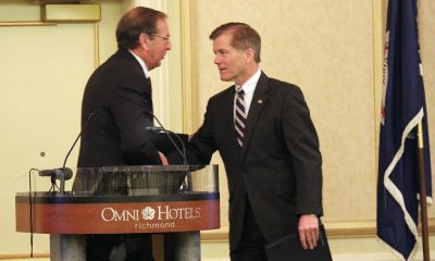 Ambassador Richard Crowder, a professor of agricultural and applied economics at Virginia Tech, shakes Virginia Gov. Bob McDonnell's hand.