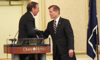 Ambassador Richard Crowder, a professor of agricultural and applied economics in the College of Agriculture and Life Sciences (left), thanks Virginia Gov. Bob McDonnell for his work to increase the state's agricultural exports. McDonnell cited Virginia Tech's role in boosting agricultural production.