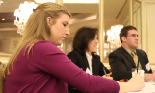 From left: Maggie Lawson, who received a degree in agricultural and applied economics in 2012, Olivia Movafaghi from Hollis, N.H., an accelerated masters student in agricultural and applied economics, and Andrew Miller from Bassett, Va., a senior majoring in agricultural and applied economics, attend the Governor's Conference on Agricultural Trade.