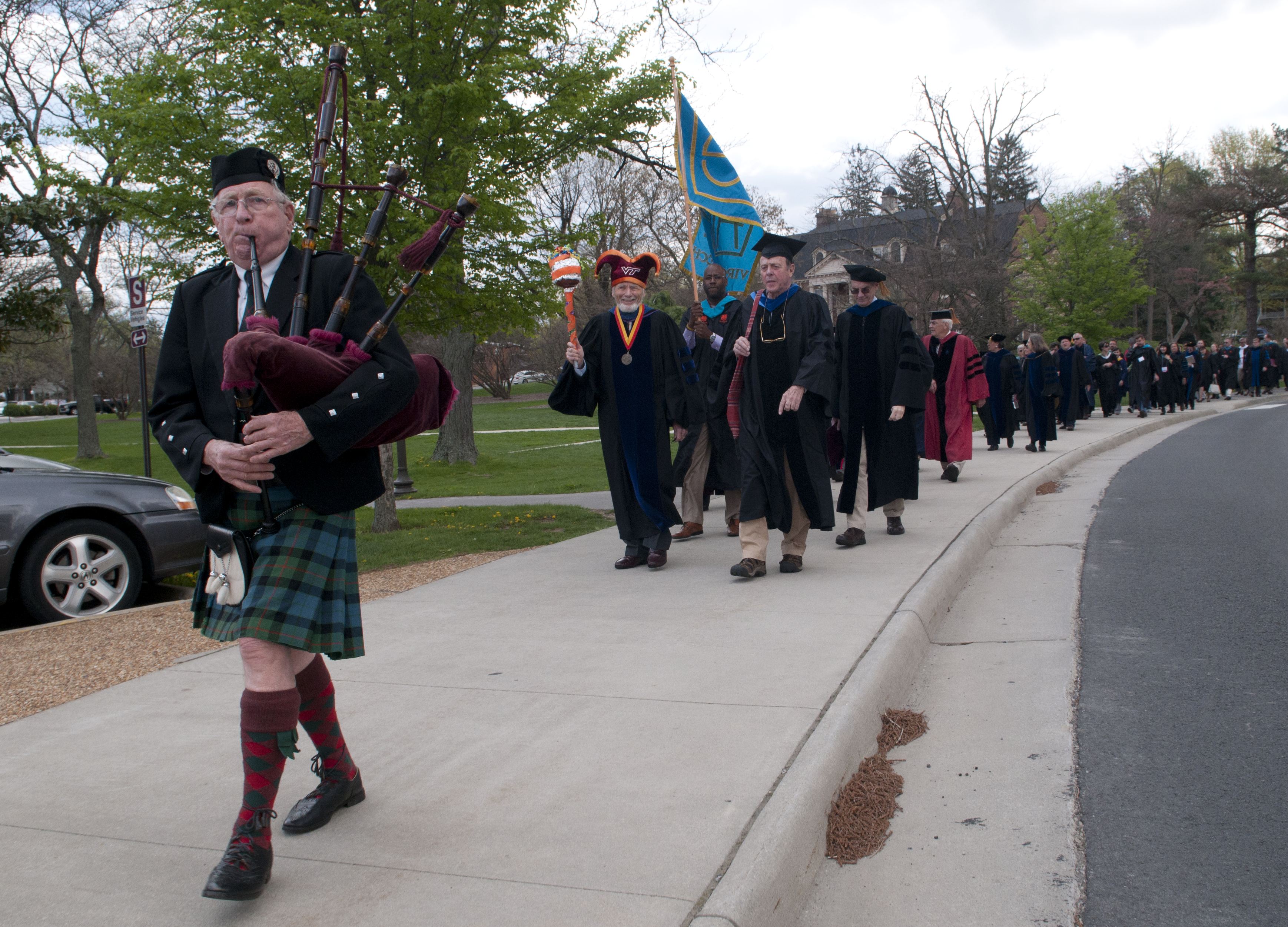 A procession of faculty and students in academic robes.