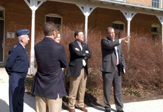 Virginia Secretary of Natural Resources Doug Domenech (second from right), recently toured the Upper Quad with university leadership to understand design concepts new facilities for the Virginia Tech Corps of Cadets and the preservation of Lane Hall.