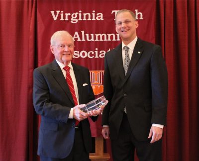 Alan Grant (right), dean of the College of Agriculture and Life Sciences, presents George E. Russell with an award as he is inducted in the Virginia Tech College of Agriculture and Life Sciences Hall of Fame.