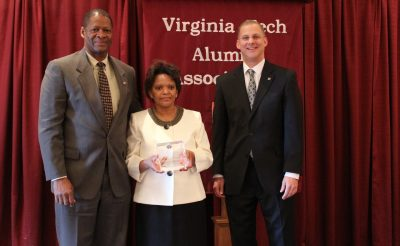 Alan Grant (right), dean of the College of Agriculture and Life Sciences, presents Winston and Marilyn Samuels with an award as they are inducted in the college's Hall of Fame.