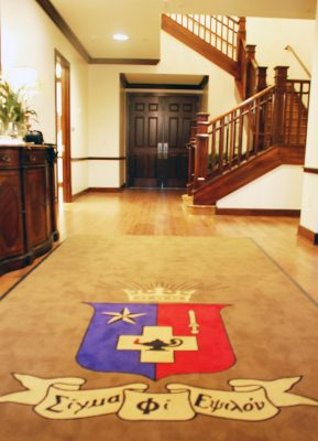 Carpet with crest in the fraternity house entrance.