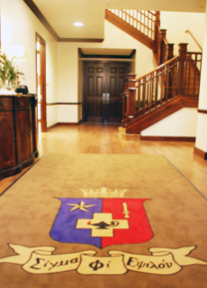 The new Sig Ep house welcomes residents and guests with the fraternity's crest.