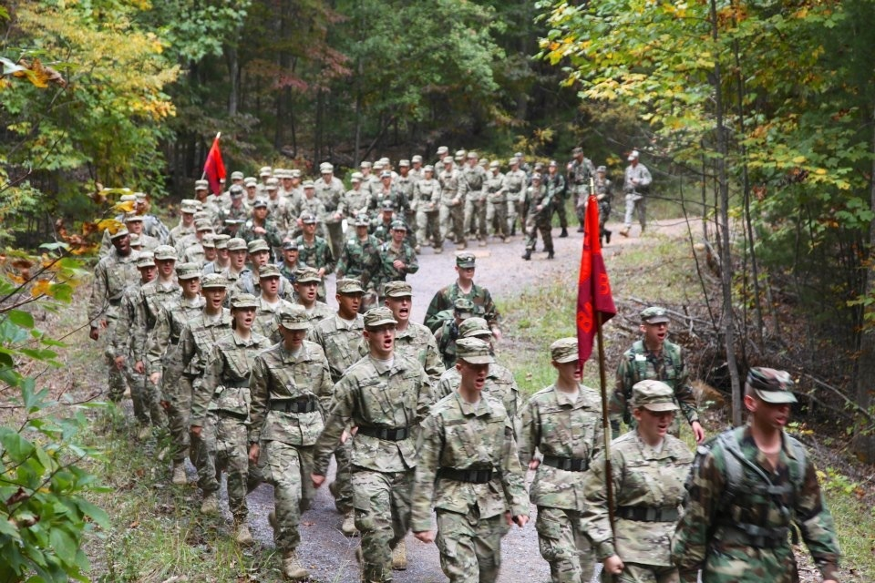 Members of the Class of 2016 march together through the woods on the Fall Caldwell March last September.