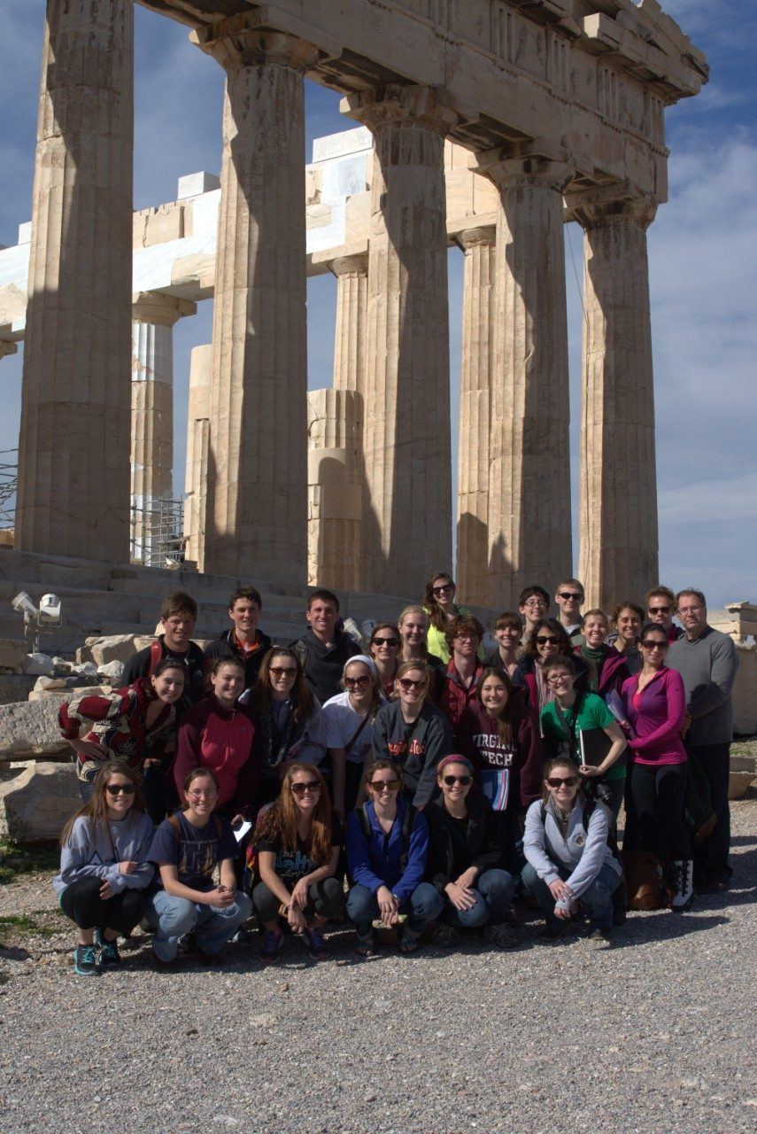 The 28 student participants and Director of University Honors Terry Papillon pose at the Parthenon in Athens, Greece.