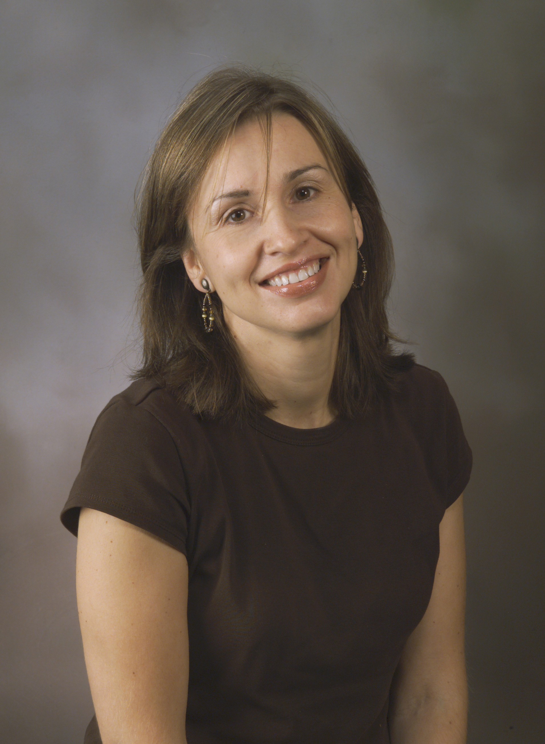 Studio head and shoulders portrait of Sonia Hirt.