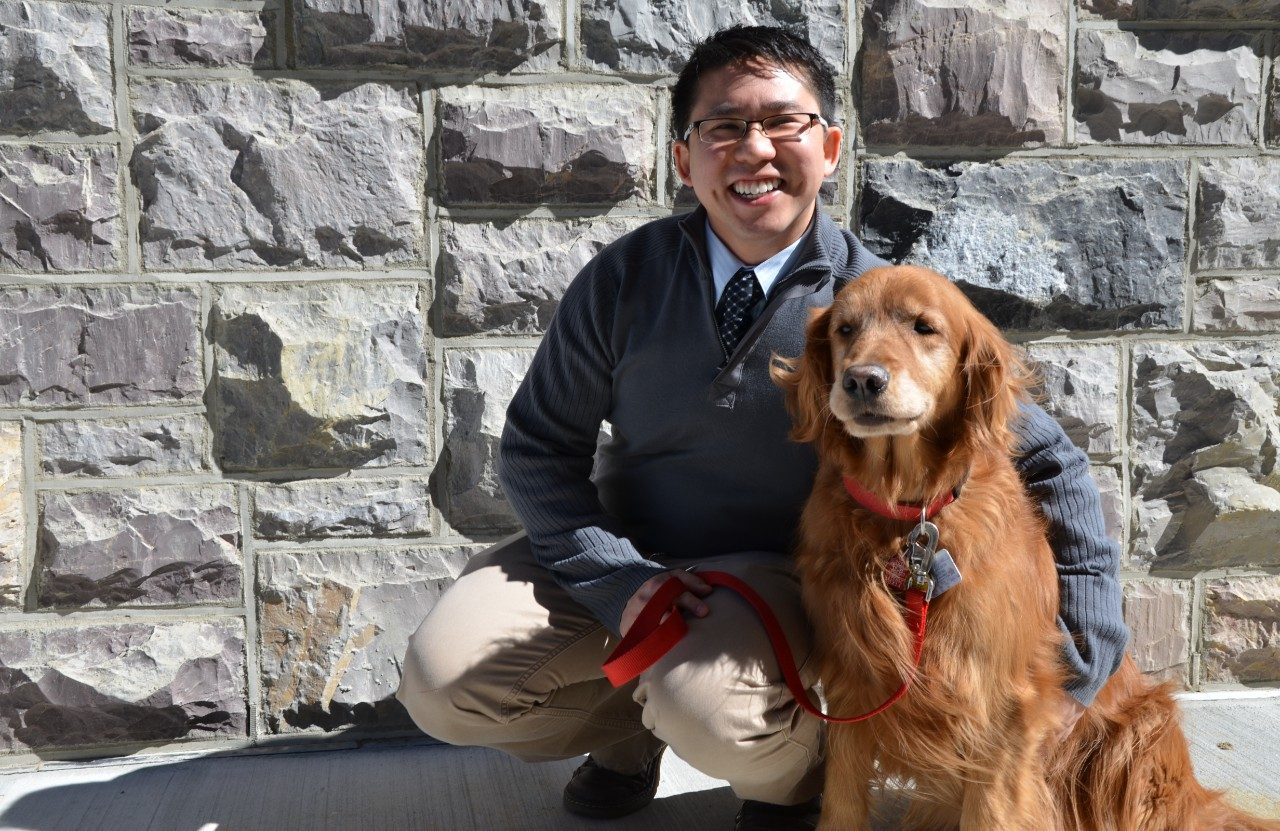 "Dr. Zenithson ""Zenny"" Ng with his certified therapy dog, Grace."