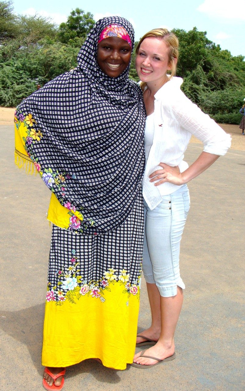 Victoria Heath (right) stands with Sophia, a staff member at the Kakuma Refugee Camp in Kenya.