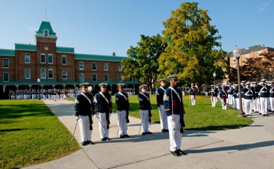 Corps of Cadets in dress uniform, in formation.