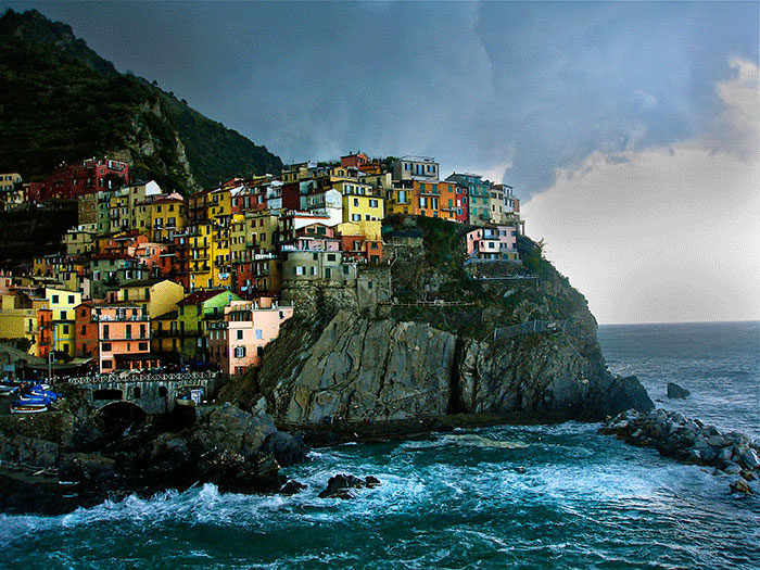 View of Manarola, Cinque Terre, Italy as a hail storm approaches.