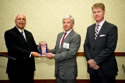 Retiring Pamplin College dean Richard E. Sorensen is presented the Distinguished Leadership Award of AACSB International by its president and CEO John Fernandes (left). On the far right is AACSB vice president of outreach, Michael Wiemer.