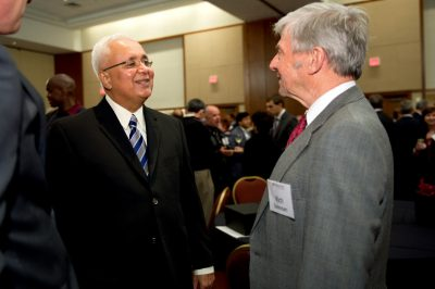 AACSB International president and CEO John Fernandes (left) chats with Pamplin College dean Richard E. Sorensen at the dean's retirement reception.