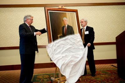 The portrait of retiring Pamplin College dean Richard E. Sorensen is officially unveiled by president Charles Steger (left) and finance professor and department head Art Keown.