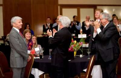 Pamplin College of Business dean Richard E. Sorensen receives a standing ovation at his retirement reception from Pamplin faculty, staff, alumni, university officials, and other guests.