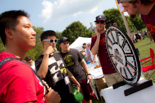 Students at one of the many Gobblerfest booths try to win a prize.